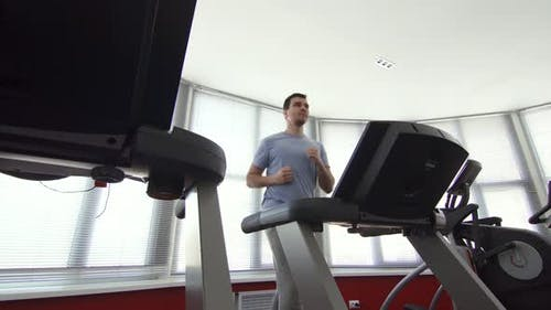 Man Over 30 Years Old on a Running Simulator