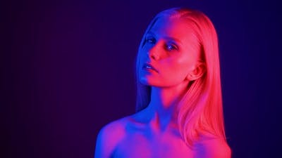 Fashion Model Woman in Neon Light Portrait of Beautiful Model Girl with Fluorescent Powder Makeup