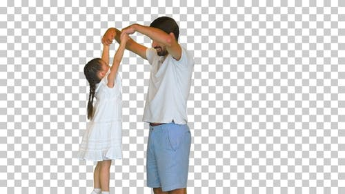 Happy dad is lifting up his little daughter, Alpha Channel