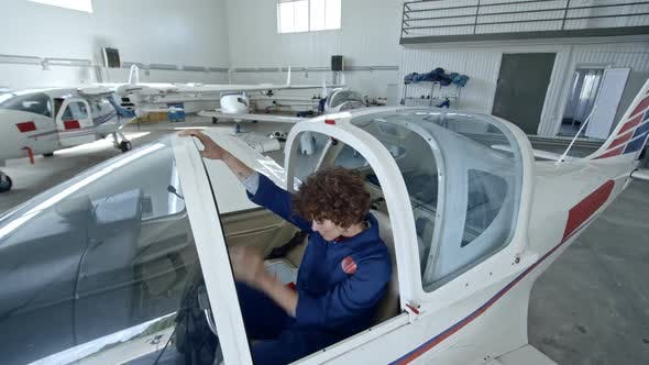 Thumbnail for Woman Pilot Sitting in Cabin of Jet Airplane