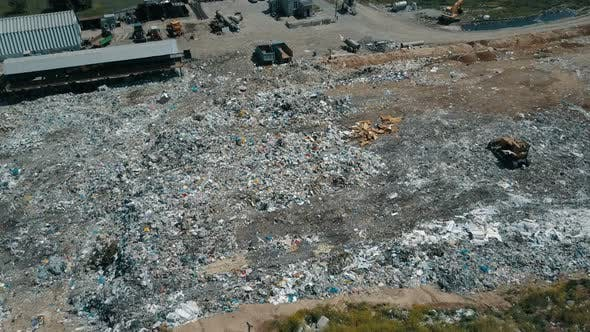 Thumbnail for Aerial View of City Garbage Dump. Gulls Feeding on Food Waste Fly Over It
