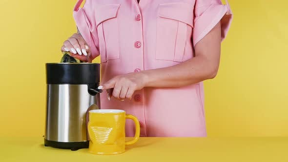 Thumbnail for Girl Makes Fresh Peach Juice with a Juicer. Home Cooking. Healthy Food, Natural Fresh Juice. Close