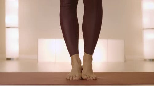 Barefoot Woman Standing on Mat in Class. Woman Legs Doing Tree Pose in Studio
