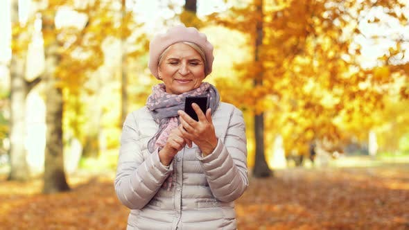 Thumbnail for Happy Senior Woman with Smartphone at Autumn Park 12