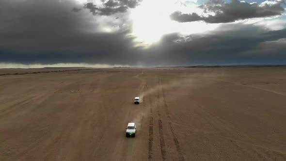 Vehicles Driving on Wide Dirt Roads in Central Asian Steppes