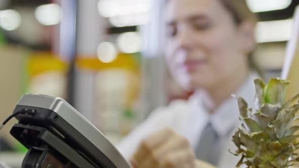 Thumbnail for Cashier Swiping Credit Card at Register