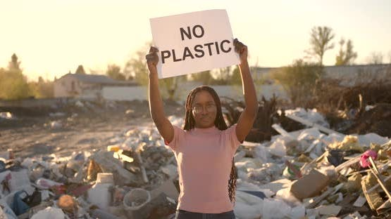 African American Woman Holding Save the Planet Sign
