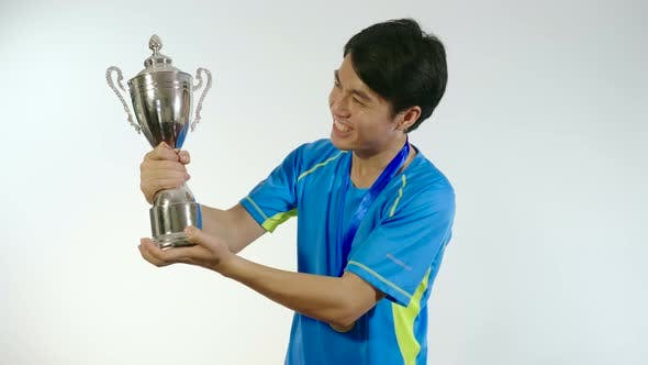 Man Kiss Trophy And Celebrating