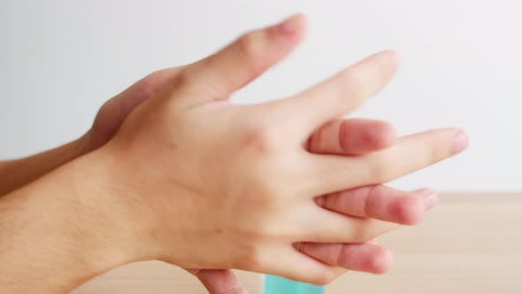 Asian woman using alcohol spray hand sanitizer wash hand for protect coronavirus.