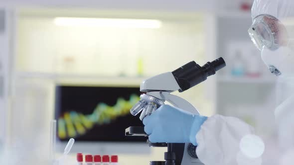 Thumbnail for Research Scientist Looking at Sample under Microscope