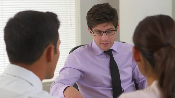 Thumbnail for couple talking to a businessman