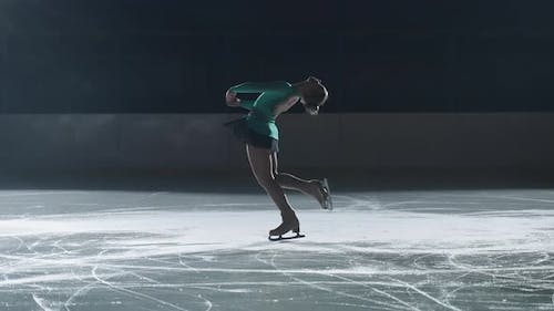 Graceful Girl Performs a Pirouette on Skates Teenage Figure Skater Perfects the Execution of