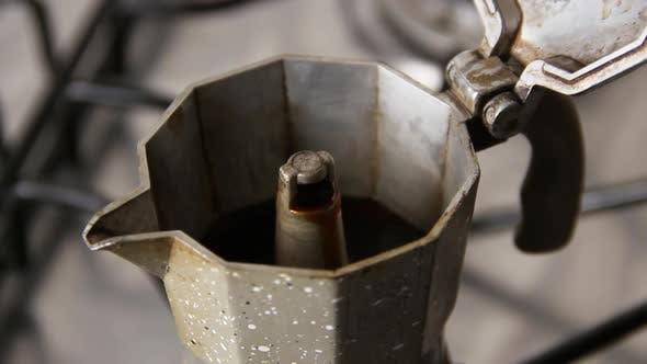 The process of making coffee in Italian moka pot
