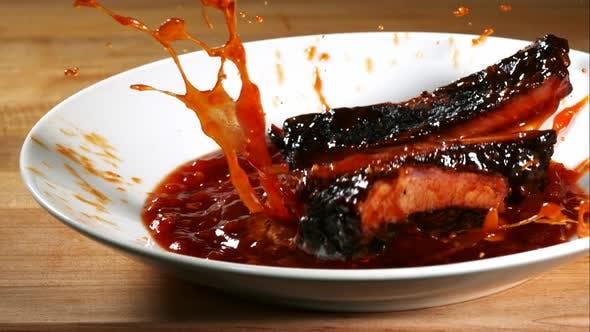BBQ rips splashing in ultra slow motion 1500fps into BBQ sauce - BBQ PHANTOM