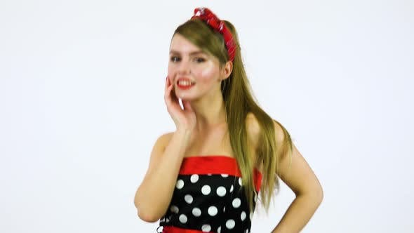 Thumbnail for A Beautiful 50s Pin-up Girl Dances and Smiles at the Camera - White Screen Background