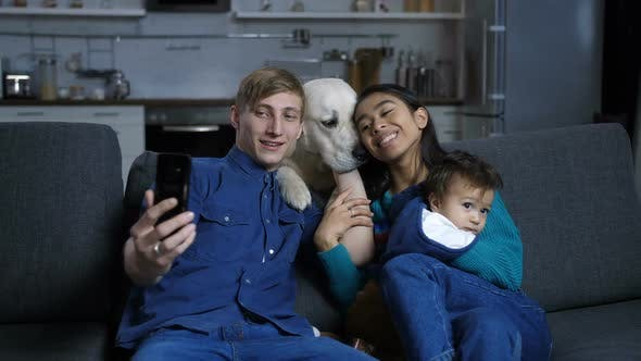 Thumbnail for Smiling Family with Dog Taking Sefie on Cellphone