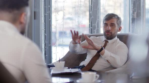 Thumbnail for Two Businessmen on Business Meeting