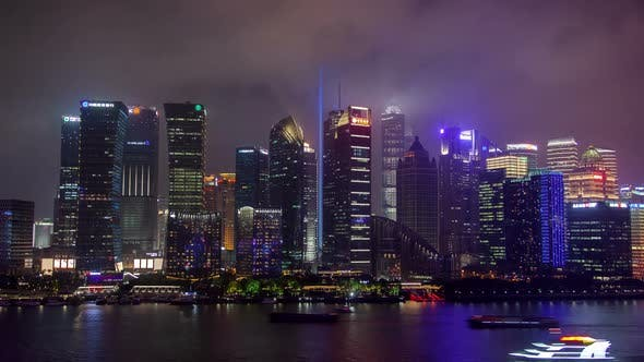 Shanghai River Urban Cityscape Aerial Skyline Panorama Timelapse at Night Zoom Out