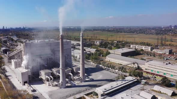Thumbnail for Aerial view. White smoke from the chimneys of an industrial plant