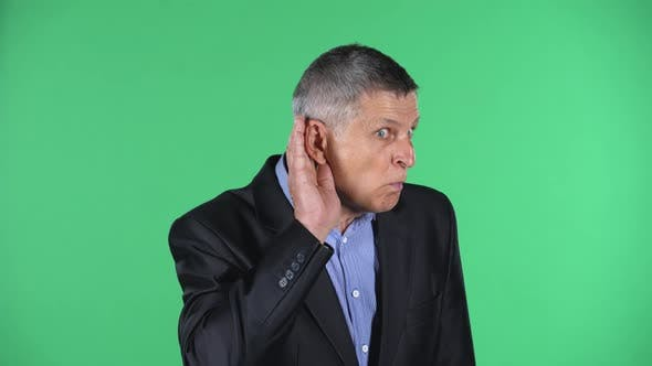 Portrait of Aged Man Holding Hand Near Ear Trying To Listen To Interesting News Expressing
