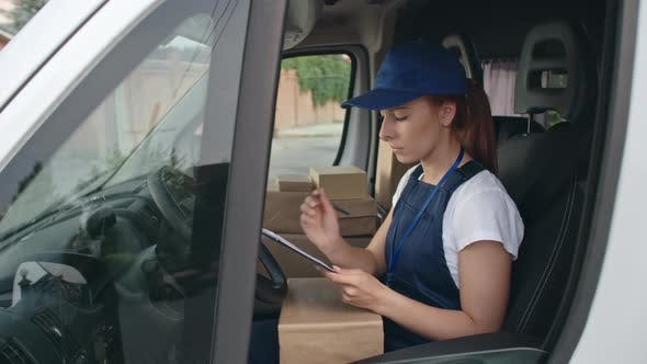 Thumbnail for Young Courier Checking Packages before Delivery