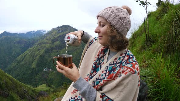 Thumbnail for Hiker Woman Pouring Tea From Thermos In Mountains