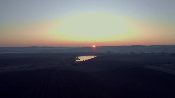 Thumbnail for Sunrise On The Field. Earth Close Up. Bright Rays Illuminate The Earth