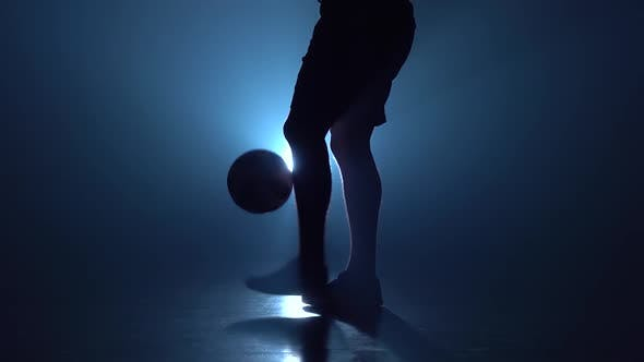 Thumbnail for Feet of Football Player Are Stuffing the Ball in Twilight