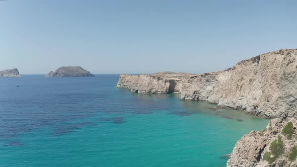 Wide Aerial Drone View Over Greek Island Milos in Summer with Turquoise Blue Aegean Sea