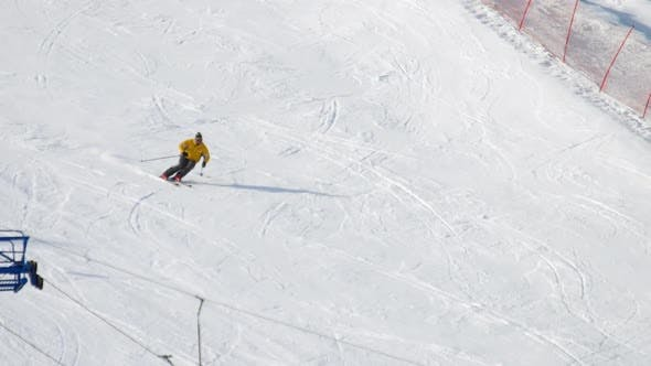 Thumbnail for Man Skier Running Downhill