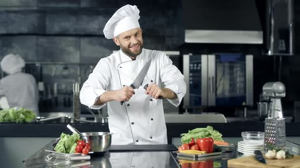 Thumbnail for Chef Man Preparing To Cook at Kitchen Restaurant