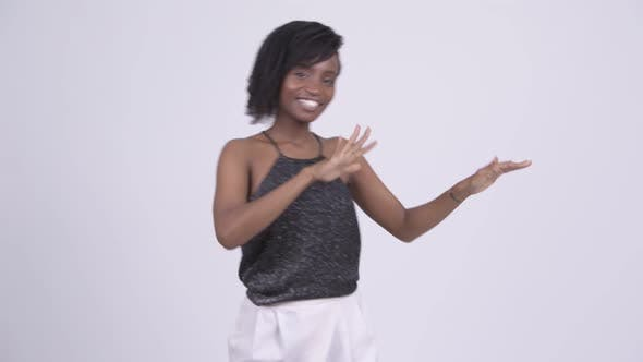 Thumbnail for Happy Young Beautiful African Woman Clapping Hands Ready To Party