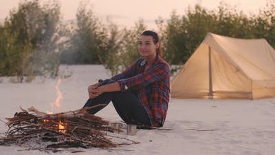 Tourist Woman in the Camp Near Campfire