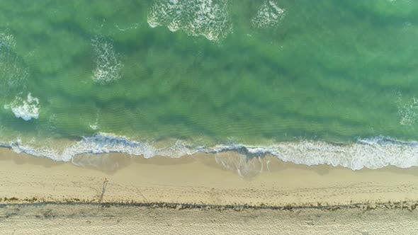 Thumbnail for Sea with Waves and Sandy Beach in Sunny Morning. Aerial Vertical Top-Down View