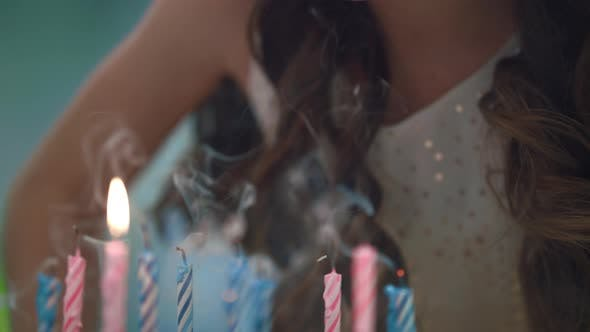 Thumbnail for Girl Blowing Candles on Party Cake. Kids Birthday Celebration Tradition