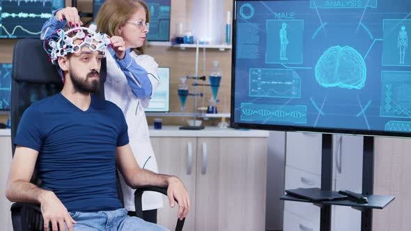 Male Patient in Modern Technology on His Head for Reading Brain Activity