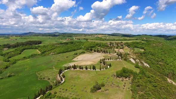 Tuscany Aerial with Road and Cypresses on Hills