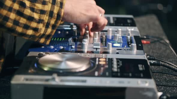 Thumbnail for Close Up of DJ Hands Controlling a Music Table in a Night Club