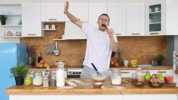 Thumbnail for Handsome Excited Man Singing At Kitchen