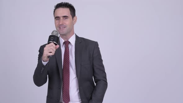 Thumbnail for Handsome Businessman Singing with Microphone