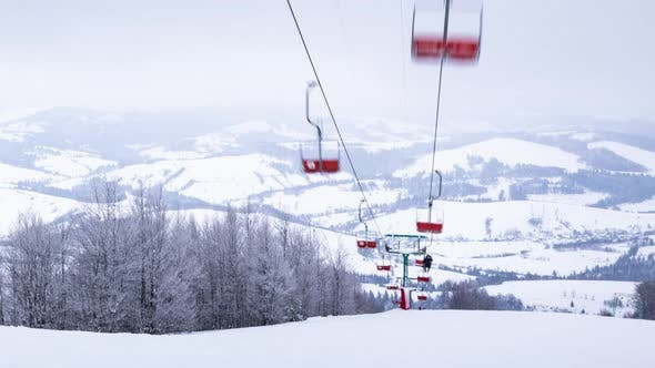 Ski Lift Skiers and Snowboarders Resort in Carpatian Mountains Time Lapse