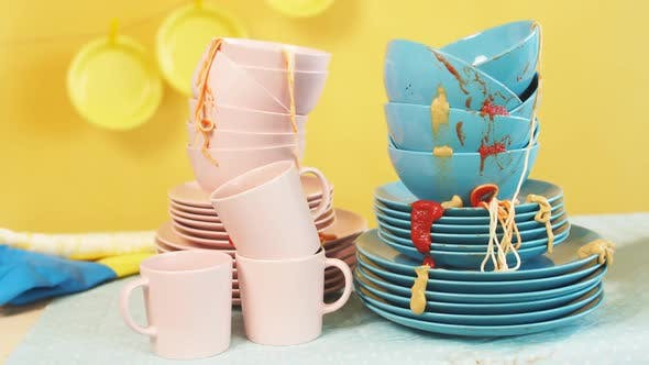 Thumbnail for Pile of Dirty Colorful Kitchenware in Yellow Background