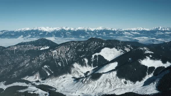 Aerial View of the Snowy High Tatras Mountains in Clear Weather. Slovakia, Chopok