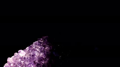 Seamlessly Rotating a Purple Mineral (Amethyst) in Front of Black Background.