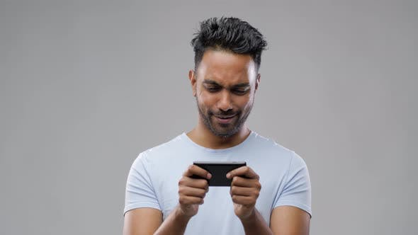 Thumbnail for Happy Indian Man Playing Game on Smartphone 48