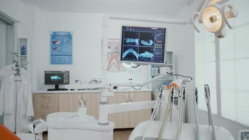 Interior of Empty Stomatology Orthodontist Office Room Equipped with x Ray on Monitors