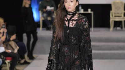 Chinese Asian Fashion Model on Catwalk Podium