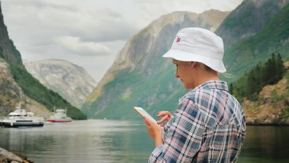 Thumbnail for A Tourist Uses a Smartphone on the Background