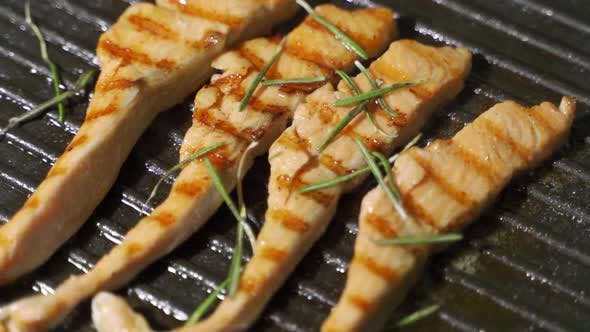 Thumbnail for Fish Cooking Recipe. Piece of Salmon or Trout Fillet Frying on Grilled Pan