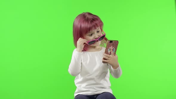 Thumbnail for Girl Using Smartphone. Child Emotionally Talking on Mobile Phone, Take Selfie